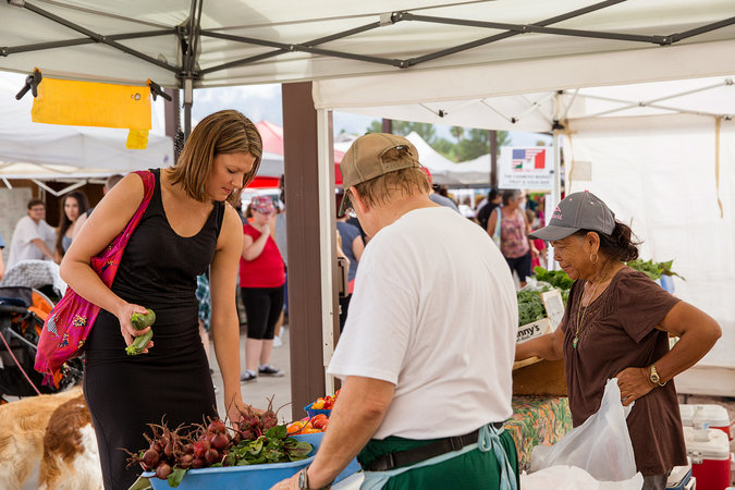 Megan Kimble, the editor of Edible Baja Arizona magazine, shopping at a farmers' market in Tucson. Credit Chris Hinkle for The New York Times