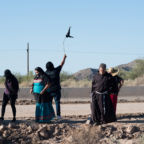 Tribal members and supporters gather in front of the construction line to wave down O'odham runners coming from Sonora ahead of a cross-border ceremony at Quitobaquito Springs on Sept. 27, 2020. Alisa Reznick/AZPM